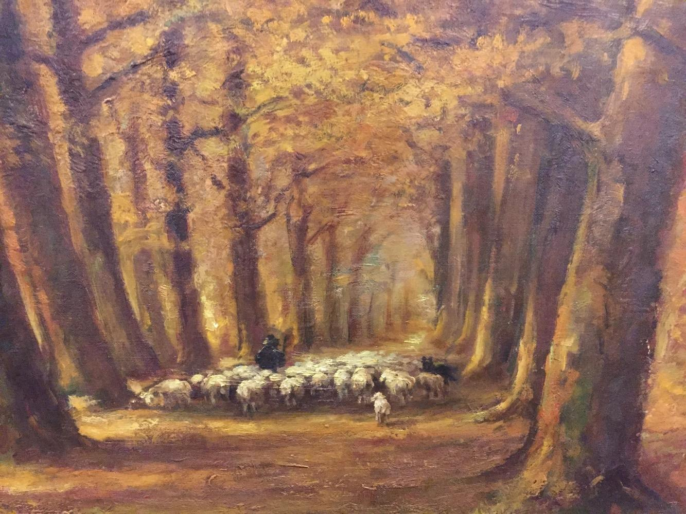 Shepherd with sheep in the forest