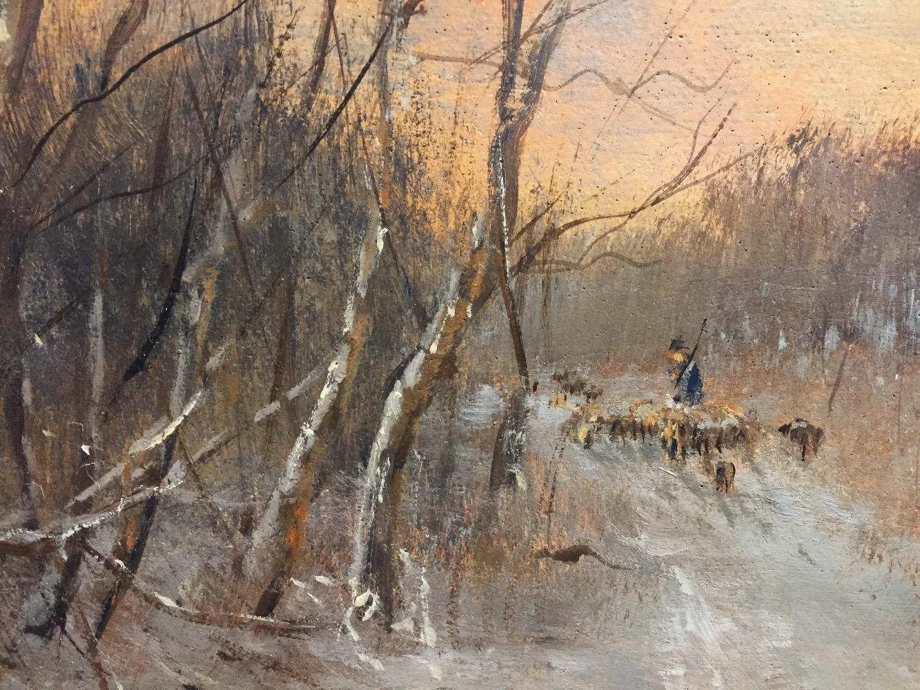 Shepherd with his sheep in the wintertime