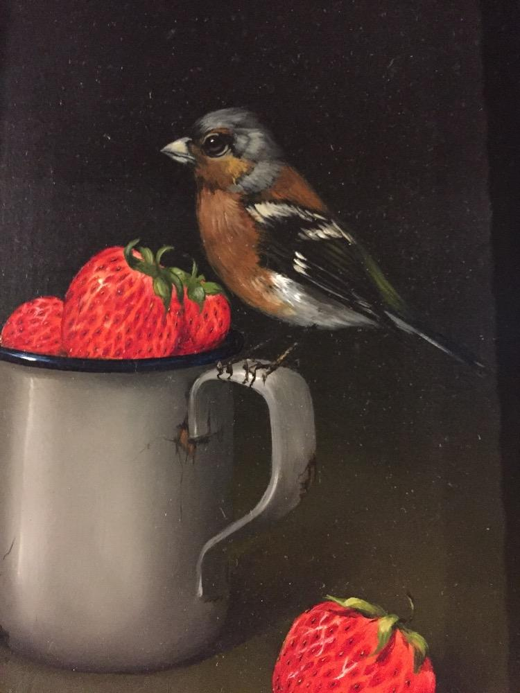 Bird eating strawberries